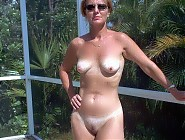 Naked naturist mature women on backyard