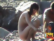 (12 pictures) Gorgeous dark hair teen explores the nude beach