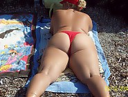 (7 pictures) Fat nudist moms and grannies sunbathing nude on beach